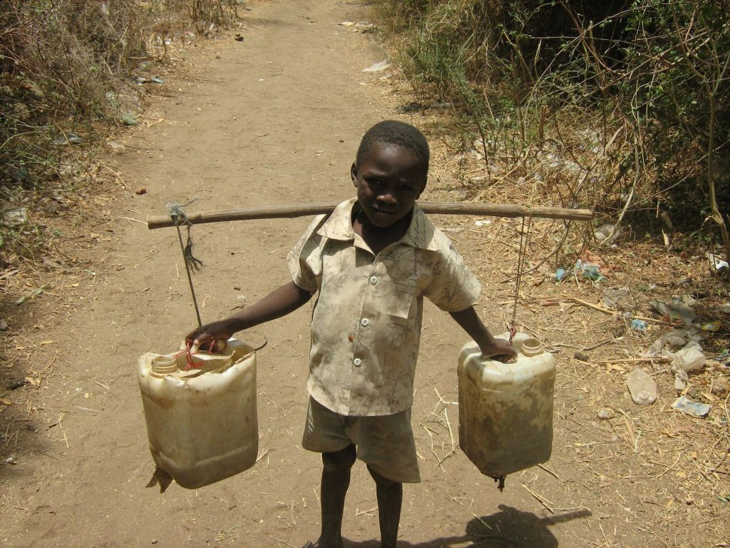 poor kid with water